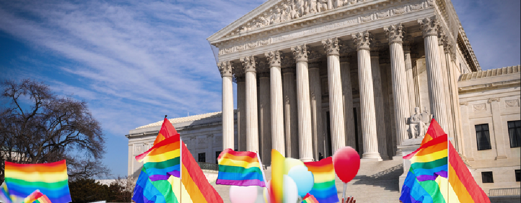 rainbow flags in front of U.S. Supreme Court building
